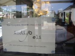 window sign indigo eli cafe poet croydon store